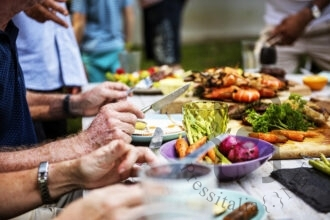 closeup-of-diverse-people-enjoying-barbecue-party-together-in